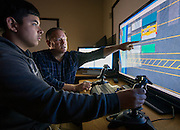 Students practice loading shipping containers on a simulator at Austin High School, January 21, 2015.