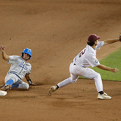 Jun 24, 2013; Omaha, NE, USA; UCLA Bruins center fielder Brian Carroll (24) steals second base against Mississippi State Bulldogs shortstop Adam Frazier (right) during the seventh inning in game 1 of the College World Series finals at TD Ameritrade Park. Mandatory Credit: Derick E. Hingle-USA TODAY Sports