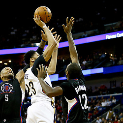 Dec 28, 2016; New Orleans, LA, USA;  New Orleans Pelicans forward Anthony Davis (23) shoots over Los Angeles Clippers center Marreese Speights (5) and forward Luc Mbah a Moute (12) during the second half of a game at the Smoothie King Center. The Pelicans defeated the Clippers 102-98. Mandatory Credit: Derick E. Hingle-USA TODAY Sports