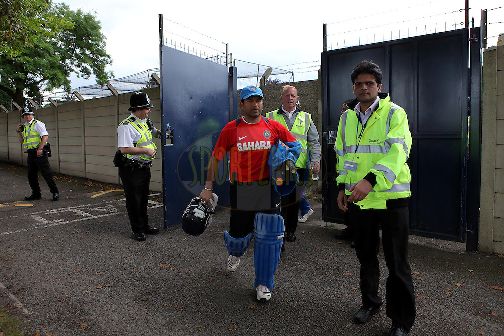 India's Sachin Tendulkar leaves under increased security during the India practice session at Grace Road Cricket Ground in Leicester, England on the 28th August 2011...Photo by Ron Gaunt/SPORTZPICS/BCCI