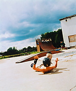 Youth fallen off from his BMX lying on the floor, Romford Skate Park, UK 1990's