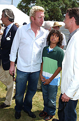 """Left to right, BORIS BECKER, his son and DAVID COULTHARD at a luncheon hosted by Cartier at the 2005 Goodwood Festival of Speed on 26th June 2005.  Cartier sponsored the """"Style Et Luxe' for vintage cars on the final day of this annual event at Goodwood House, West Sussex. <br /><br />NON EXCLUSIVE - WORLD RIGHTS"""