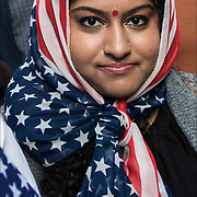Thousand, representing myriad backgrounds and faiths, converged on Times Square on Sunday, to let Muslims know their fellow Americans stood by them.<br /> <br /> The demonstrators -- many of them hoisting placards featuring a woman in an American flag hijab with the caption &quot;we the people are greater than fear, gathered to denounce what they see as threats and pressure aimed at Muslim communities. <br /> <br /> The rally, dubbed &quot;Today I am a Muslim Too,&quot; was billed on social media as &quot;a day of solidarity with our Muslim brothers and sisters in reaction to the vicious attacks by(President Donald Trump.&quot;<br /> <br /> Trump has made numerous disparaging remarks about Muslims and an appeals court recently put a halt to his executive order that temporarily barred all refugees and travelers from seven predominantly Muslim countries from entering the country. Trump has vowed to issue a new order tailored to the court's decision.
