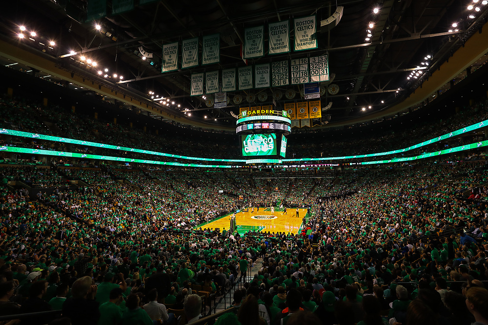 This Boston sport photo image of the Boston Celtics at the TD Garden is available as museum quality photography prints, canvas prints, acrylic prints, wood prints or metal prints. Wall art prints may be framed and matted to the individual liking and decorating needs:<br /> <br /> https://juergen-roth.pixels.com/featured/the-boston-celtics-juergen-roth.html<br /> <br /> Boston Celtics playing Washington Wizards in the NBA basketball eastern conference semi final game 7 at the TD Garden in Boston. The C's are an American professional basketball franchise based in Boston, Massachusetts. They play in the Atlantic Division of the Eastern Conference in the National Basketball Association and the C-Green Smash Machine holds 17 NBA titles: 2008, 1986, 1984, 1981, 1976, 1974, 1969, 1968, 1966, 1965, 1964, 1963, 1962, 1961, 1960, 1959, 1957.<br /> <br /> Good light and happy photo making!<br /> <br /> My best,<br /> <br /> Juergen<br /> Image Licensing: http://www.RothGalleries.com <br /> Fine Art Prints: http://juergen-roth.pixels.com<br /> Photo Blog: http://whereintheworldisjuergen.blogspot.com<br /> Twitter: https://twitter.com/naturefineart<br /> Facebook: https://www.facebook.com/naturefineart <br /> Instagram: https://www.instagram.com/rothgalleries