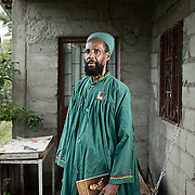 Priest Maul of the Bobo Shanti Church.<br /> <br /> Originally from Trinidad, Priest Maul repatriated 9 years ago.<br /> <br /> He is holding a book about Marcus Garvey, who is considered a prophet by their Mansion.