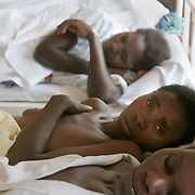 July, 15, 2006 - A woman receiving ARV treatment rests with other patients at the district hospital in Rwinkwavu, Rwanda, which the Clinton Foundation renovated in partnership with Dr. Paul Farmer's Partners in Health. Photo by Evelyn Hockstein