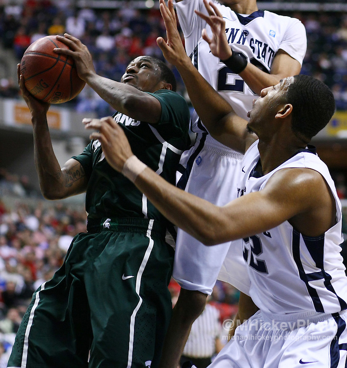 March 12, 2011; Indianapolis, IN, USA; Michigan State Spartans guard Kalin Lucas (1) goes up for a shot against Penn State Nittany Lions guard Tim Frazier (23) and Penn State Nittany Lions forward Andrew Jones (22) in the semi-final round of the 2011 Big Ten Tournament at Conseco Fieldhouse. Penn State defeated Michigan State 61-48. Mandatory credit: Michael Hickey-US PRESSWIRE