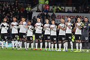 Derby County players line up to pay tribute to Jim Smith before the EFL Sky Bet Championship match between Derby County and Sheffield Wednesday at the Pride Park, Derby, England on 11 December 2019.