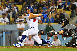 May 9, 2018 - Los Angeles, CA, U.S. - LOS ANGELES, CA - MAY 09: Los Angeles Dodgers Catcher Austin Barnes (15) hits a single during a MLB game between the Arizona Diamondbacks and the Los Angeles Dodgers on May 9, 2018 at Dodger Stadium in Los Angeles, CA. (Photo by Brian Rothmuller/Icon Sportswire) (Credit Image: © Brian Rothmuller/Icon SMI via ZUMA Press)