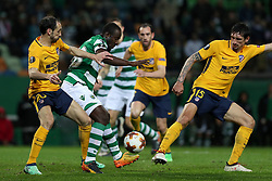 April 12, 2018 - Lisbon, Portugal - Sporting's forward Seydou Doumbia from Ivory Coast (C ) vies with Atletico Madrids defenders Juanfran of Spain (L) and Stefan Savic of Montenegro (R )  during the UEFA Europa League second leg football match Sporting CP vs Atletico Madrid at Alvalade stadium in Lisbon, on April 12, 2018. (Credit Image: © Pedro Fiuza/NurPhoto via ZUMA Press)
