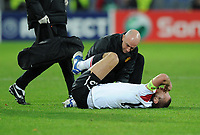 Football - Champions League - FC Basel vs. Manchester United<br /> Nemanja Vidic of Manchester United lies injured and in agony at St. Jakob Park, Basel