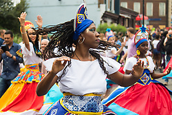 London, August 28th 2016. A woman dances on Kensal Road as Europe's biggest street party, the Notting Hill Carnival gets underway.