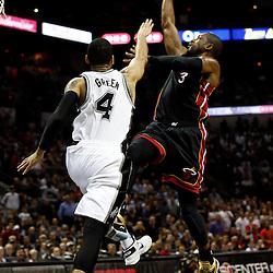 Jun 13, 2013; San Antonio, TX, USA; Miami Heat shooting guard Dwyane Wade (3) shoots against San Antonio Spurs shooting guard Danny Green (4) during the third quarter of game four of the 2013 NBA Finals at the AT&T Center. Mandatory Credit: Derick E. Hingle-USA TODAY Sports