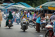 10 JULY 2013 - PATTANI, PATTANI, THAILAND:  The night market near Krue Se Mosque in Pattani, Thailand. The market opens late every afternoon during Ramadan to sell food for Iftar. Iftar is the meal Muslims take when they break their daily Ramadan fast. Ramadan is the ninth month of the Islamic calendar, and the month in which Muslims believe the Quran was revealed. Muslims believe that the Quran was sent down during this month, thus being prepared for gradual revelation by Jibraeel (Gabriel) to the prophet Muhammad.  The month is spent fasting during the daylight hours from dawn to sunset. Fasting during the month of Ramadan is one of the Five Pillars of Islam.     PHOTO BY JACK KURTZ