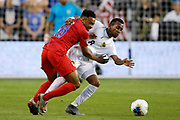 US forward Jonathan Lewis (18) and Panama midfielder Marcos Sanchez (8) battle for the ball during the first half of a CONCACAF Gold Cup soccer match in Kansas City, Kan., Wednesday, June 26, 2019. (AP Photo/Colin E. Braley)