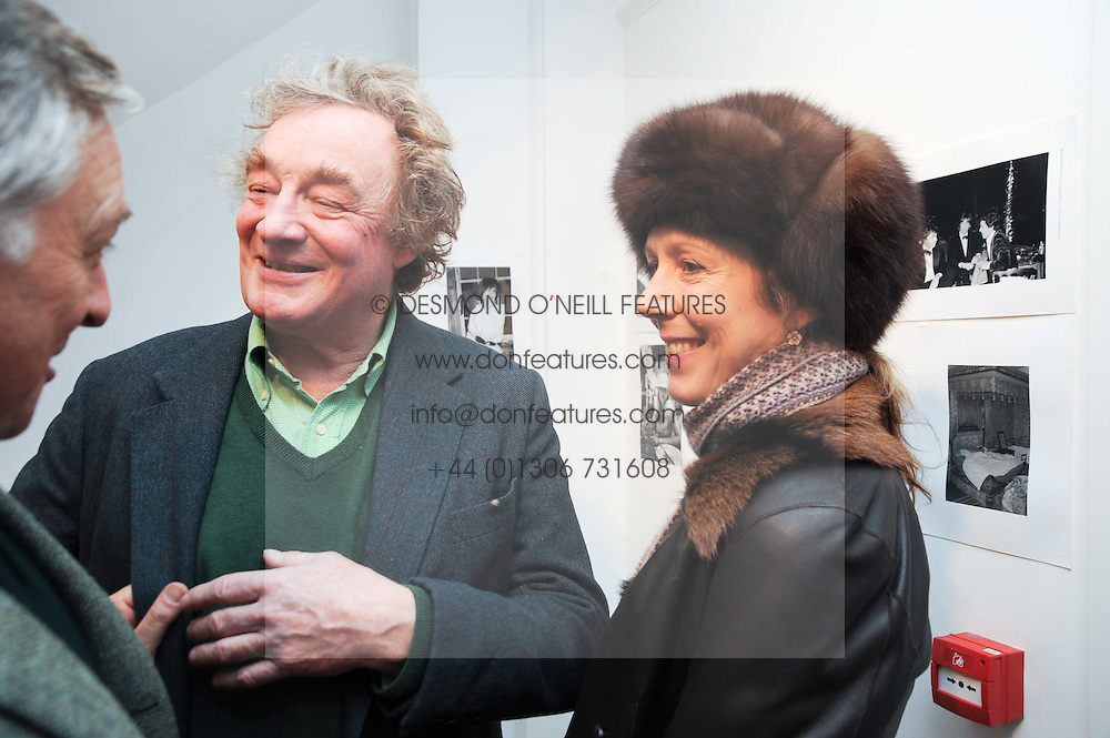 CHRISTOPHER SIMON SYKES and his wife ISABELLA at a private view of photographs by Nick Ashley held at the Sladmore Gallery, 32 Bruton Place, London on 13th January 2010.