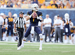 Sep 16, 2017; Morgantown, WV, USA; West Virginia Mountaineers quarterback Will Grier (7) drops back to pass during the first quarter against the Delaware State Hornets at Milan Puskar Stadium. Mandatory Credit: Ben Queen-USA TODAY Sports