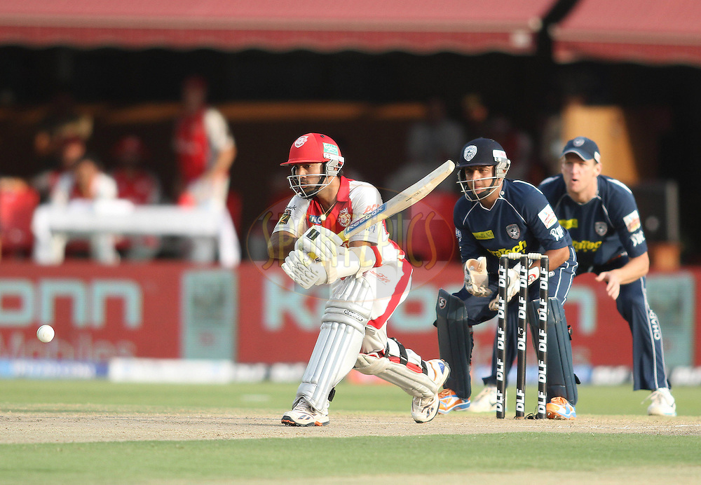 Dinesh Karthik of the Kings XI Punjab reverse sweeps a delivery during match 67 of the Indian Premier League ( IPL ) Season 4 between the Kings XI Punjab and the Deccan Chargers held at the The HPCA Stadium in Dharamsala, Himachal Pradesh, India on the 21st May 2011..Photo by Shaun Roy/BCCI/SPORTZPICS