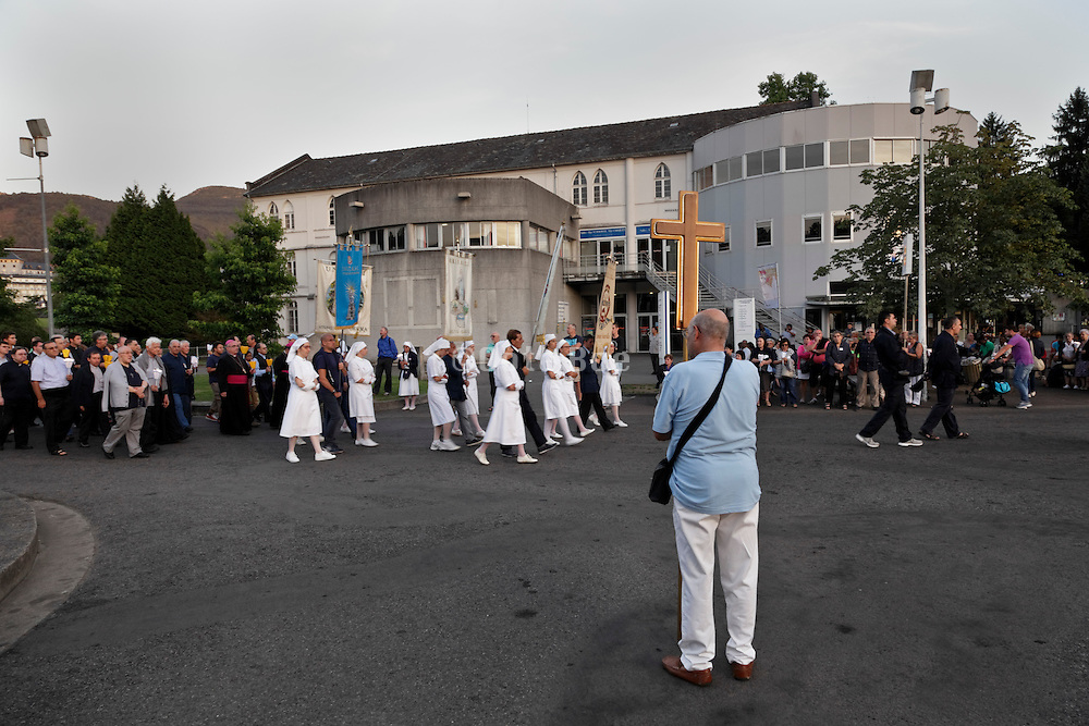 candle parade held every evening by the basilica of the immaculate conception Notre Dame of Lourdes in France