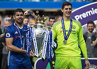 Football - 2016 / 2017 Premier League - Chelsea vs. Sunderland <br /> <br /> Diego Costa of Chelsea and Thibaut Courtois pose with the trophy at Stamford Bridge.<br /> <br /> COLORSPORT/DANIEL BEARHAM