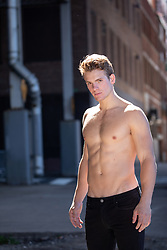 hot muscular shirtless man on the street in New York City
