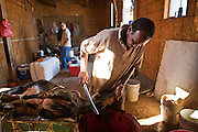 30 OCTOBER 2010 - PHOENIX, AZ: IBRAHIM SWARA-DAHAB kills a goat at the Goat Meat Store, owned by Ibrahim Swara-Dahab, in Phoenix, AZ. Swara-Dahab came to the United States from Somalia in 1998. He has built a thriving business as a Halal butcher and provides freshly butchered goats and sheep killed following the precepts of Muslim tradition. His business not only caters to Muslims in the Phoenix area but also to refugees and immigrants from Africa and Asia. His small butcher shop is on the Gila River Indian Reservation, about 100 yards from the Phoenix city limits and doesn't have either running water or electricity.    Photo by Jack Kurtz
