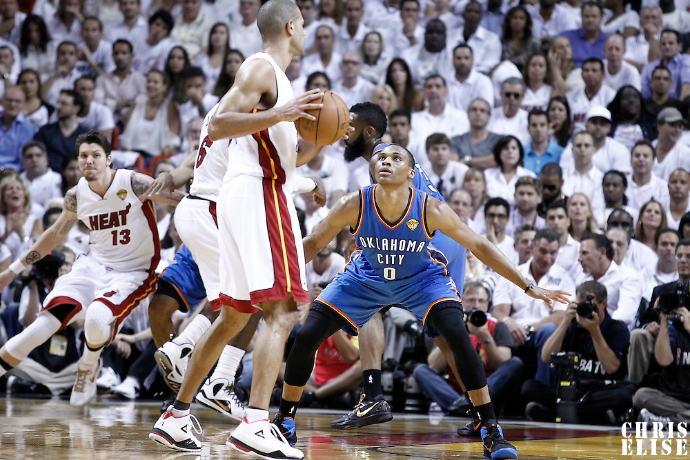 19 June 2012: Oklahoma City Thunder point guard Russell Westbrook (0) defends on Miami Heat small forward Shane Battier (31) during the first quarter of Game 4 of the 2012 NBA Finals, Thunder at Heat, at the AmericanAirlinesArena, Miami, Florida, USA.