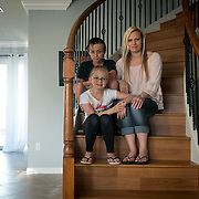 ROYAL PALM BEACH, FLORIDA, MARCH 15, 2017<br /> Cynthia Greaux, with her children; Tyler, 14, and Chloe, 8, in their home. Greaux is able to use vouchers to pay for their enrollment at a private school that specializes in educating children with dyslexia.<br /> (Photo by Angel Valentin/Freelance)