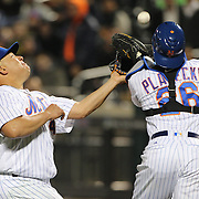 NEW YORK, NEW YORK - APRIL 26:  Pitcher Bartolo Colon #40 and catcher Kevin Plawecki #26 of the New York Mets both go for a fly ball caught by Plawecki during the New York Mets Vs Cincinnati Reds MLB regular season game at Citi Field on April 26, 2016 in New York City. (Photo by Tim Clayton/Corbis via Getty Images)
