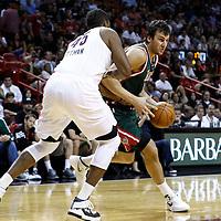 22 January 2012: Milwaukee Bucks center Andrew Bogut (6) drives past Miami Heat center Dexter Pittman (45) during the Milwaukee Bucks 91-82 victory over the Miami Heat at the AmericanAirlines Arena, Miami, Florida, USA.