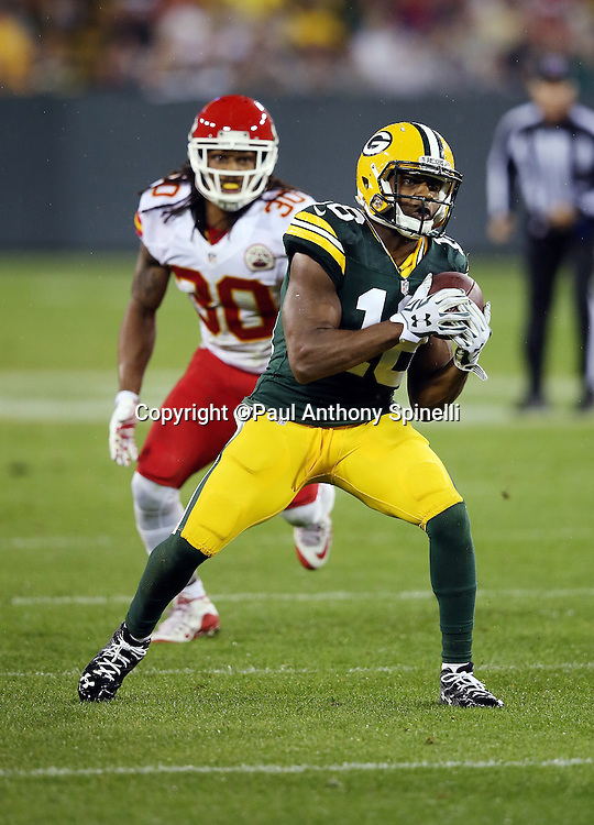 Green Bay Packers wide receiver Randall Cobb (18) catches a third quarter pass for a first down during the 2015 NFL week 3 regular season football game against the Kansas City Chiefs on Monday, Sept. 28, 2015 in Green Bay, Wis. The Packers won the game 38-28. (©Paul Anthony Spinelli)
