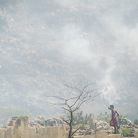 Jan 13, 2013 -  A boy stands near a mountain of burning garbage at the Dhapa dump in Kolkata, India. The mountain grows as the city piles approximately 4,500 tons of solid waste a day on top. The pollution measurements are 20% to 50% higher than safe limits at many parts of the city.<br /> <br /> Story Summary: It is said that the battle over global warming is to be won or lost in Asia. With growing populations and new economic boom in the global markets across Asia countries like India, Nepal and Cambodia have to grapple with the success and the environmental disaster that comes with ramped up production in unchecked or unregulated industries to compete in todays marketplace. The catastrophic air pollution makes for new problems to be dealt with such as a future health crisis, quality of life issues and the tarnished image of reduced visibility to world heritage sites for tourism.