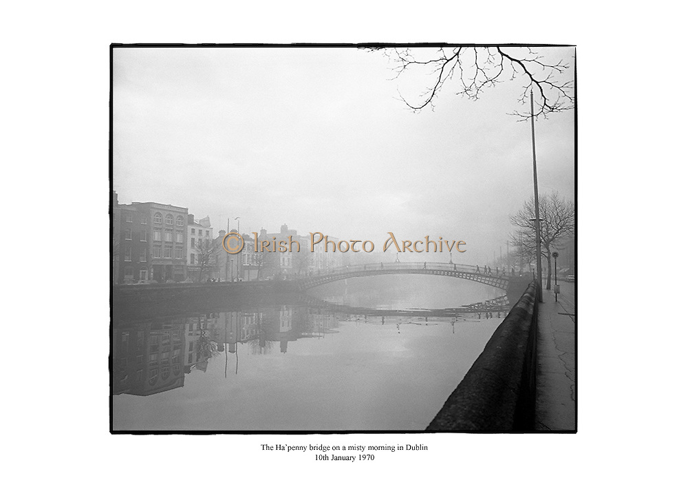The Ha'penny Bridge on a misty morning in Dublin.<br />