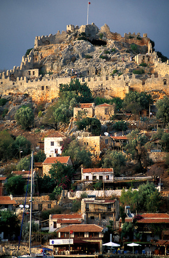 Medieval ruins of Simena Castle on top of the rocky hill above the village of Kale on the Lycian/Turquoise Coast of Southern Turkey