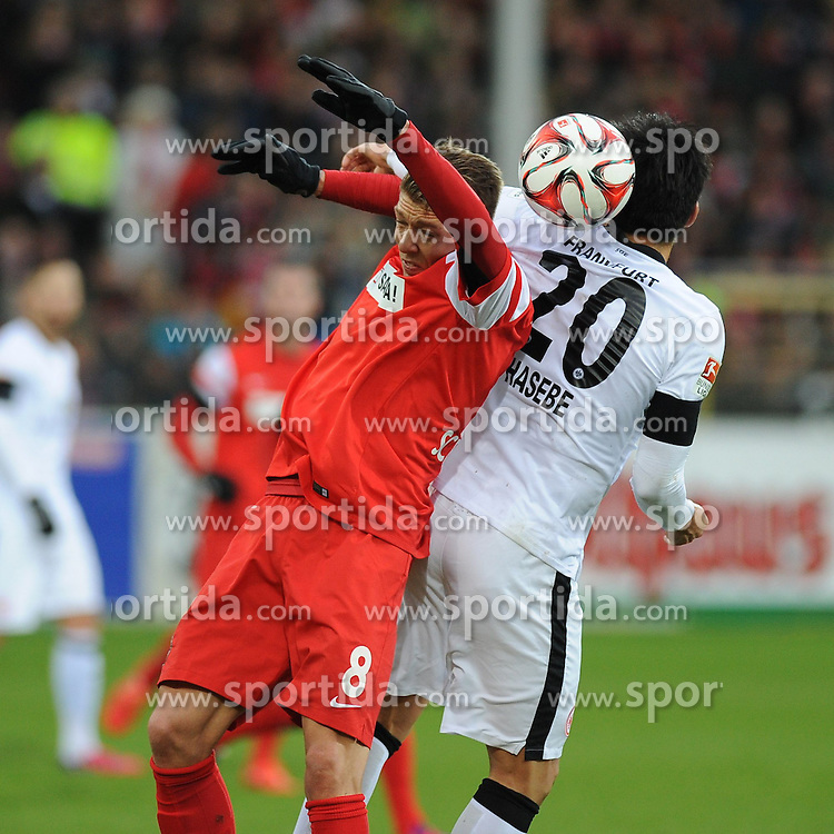 31.01.2015, Schwarzwald Stadion, Freiburg, GER, 1. FBL, SC Freiburg vs Eintracht Frankfurt, 18. Runde, im Bild Kopfballduell, Aktion zwischen (l.) Mike Franz (SC Freiburg) (r.) Makoto Hasebe (Eintracht Frankfurt) // during the German Bundesliga 18th round match between SC Freiburg and Eintracht Frankfurt at the Schwarzwald Stadion in Freiburg, Germany on 2015/01/31. EXPA Pictures &copy; 2015, PhotoCredit: EXPA/ Eibner-Pressefoto/ Laegler<br /> <br /> *****ATTENTION - OUT of GER*****