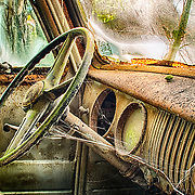 The interior of an old junker is rusting away in the Old Car City junkyard in Georgia.
