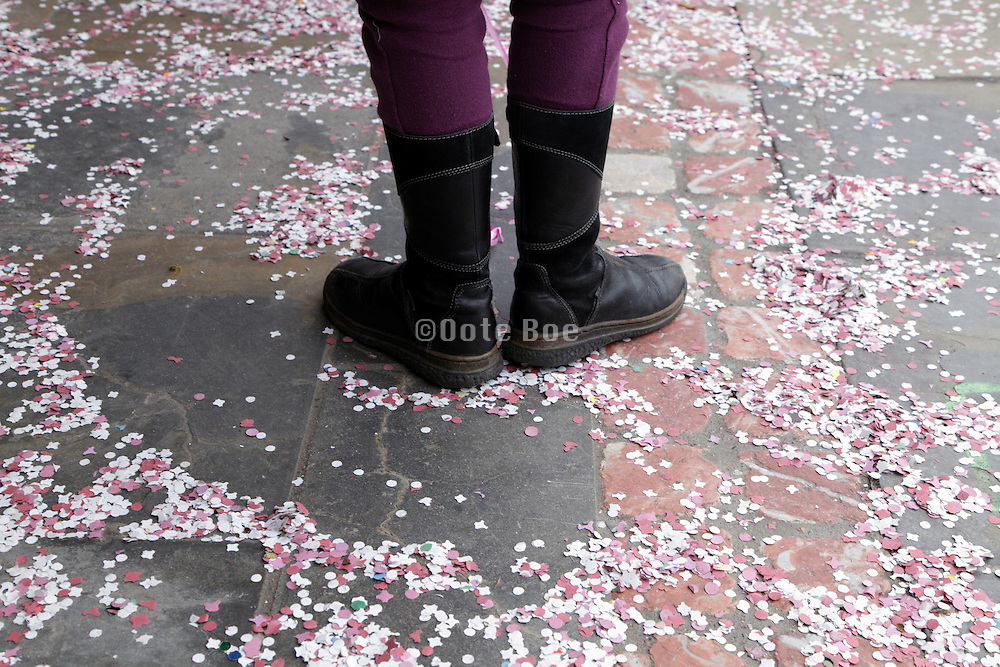 feet of a child with confetti all around