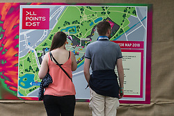 Festival goers looking at the festival map on day 1 of All Points East festival in Victoria Park in London, UK. Picture date: Friday 25 May 2018. Photo credit: Katja Ogrin/ EMPICS Entertainment.