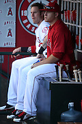 ANAHEIM, CA - AUGUST 21:  Mike Trout #27 of the Los Angeles Angels of Anaheim and Josh Hamilton #32 of the Los Angeles Angels of Anaheim sit on the bat box in the dugout during the game against the Cleveland Indians on Wednesday, August 21, 2013 at Angel Stadium in Anaheim, California. The Indians won the game 3-1. (Photo by Paul Spinelli/MLB Photos via Getty Images) *** Local Caption *** Mike Trout;Josh Hamilton