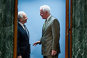Senator JOE LIEBERMAN (I-CT) speaks with Senator JOHN CORNYN (R-TX) before a Senate Armed Services Committee on Wednesday about the situation in Syria.