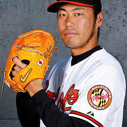 February 26, 2011; Sarasota, FL, USA; Baltimore Orioles relief pitcher Koji Uehara (19) poses during photo day at Ed Smith Stadium.  Mandatory Credit: Derick E. Hingle