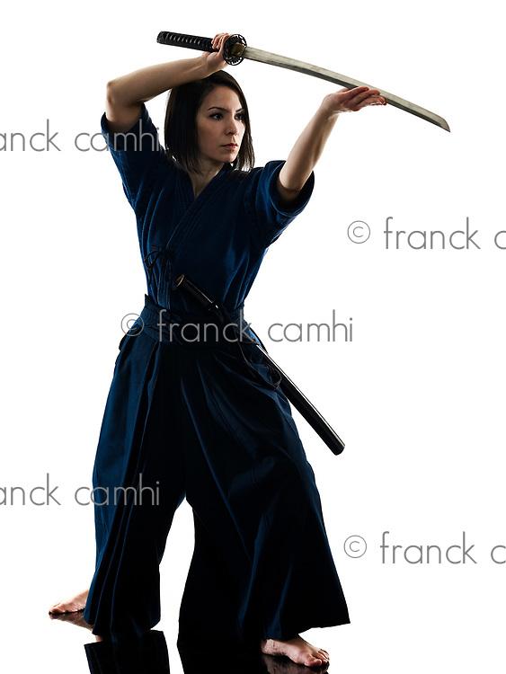 one caucasian woman practicing laido Katori Shinto ryu shadow silhouette isolated on white background