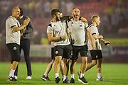Crawley Town FC coaching team celebrate the win following the EFL Cup match between Crawley Town and Norwich City at The People's Pension Stadium, Crawley, England on 27 August 2019.