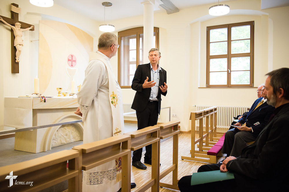 Hartmut Rademann explains his carving work in the chapel during dedication of The International Lutheran Center at the Old Latin School on Sunday, May 3, 2015, in Wittenberg, Germany. LCMS Communications/Erik M. Lunsford