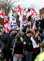 © licensed to London News Pictures. Hyde, UK  25/02/2012. The EDL demonstrate following an assault on Daniel Stringer-Prince. The victim's family said they did not want the EDL to demonstrate in their town in their son's name. It is alleged he was assulted by a gang of Asian men. At the same time, the BNP hold a rally in the town. Photo credit should read Joel Goodman/LNP