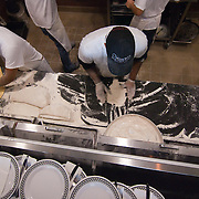 12/17/10 Wilmington DE: Kitchen Staff Left to Right: Gustavo Garcia &amp; Greg Martin working very hard to get food out to waiting customers at Anthony's Coal Fired Pizzas in Wilmington Delaware.<br /> <br /> Special to The News Journal/SAQUAN STIMPSON