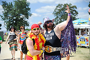 """Two Bonnaroo Music and Arts Festival attendees dressed as Hulk Hogan and Randy """"The Macho Man"""" Savage pose for a photo"""