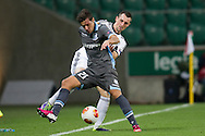 (R) Legia's Michal Kucharczyk fights for the ball with (R) Apollon's Jose Catala during the UEFA Europa League Group J football match between Legia Warsaw and Apollon Limassol FC at Pepsi Arena Stadium in Warsaw on October 03, 2013.<br /> <br /> Poland, Warsaw, October 03, 2013<br /> <br /> Picture also available in RAW (NEF) or TIFF format on special request.<br /> <br /> For editorial use only. Any commercial or promotional use requires permission.<br /> <br /> Mandatory credit:<br /> Photo by © Adam Nurkiewicz / Mediasport