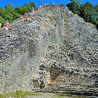 People Climbing Ixmoja Pyramid at Mayan Ruins in Coba, Mexico <br />