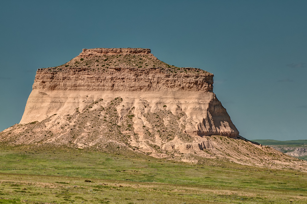 This whole area was once an ancient shallow sea. These towering buttes of sandstone are all that remain after the surrounding rock and land were washed away by climate change. The rocks are still loaded with fossils of fish and seashells. Marine dinosaur skeletons have been found in region too!